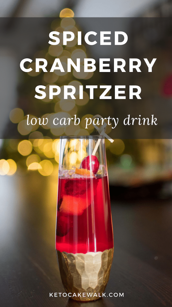 This festive holiday party drink is low in carbs and non-alcoholic so it's perfect for adults and kids alike! #lowcarb #keto #holiday #drinks #cocktail #cranberry