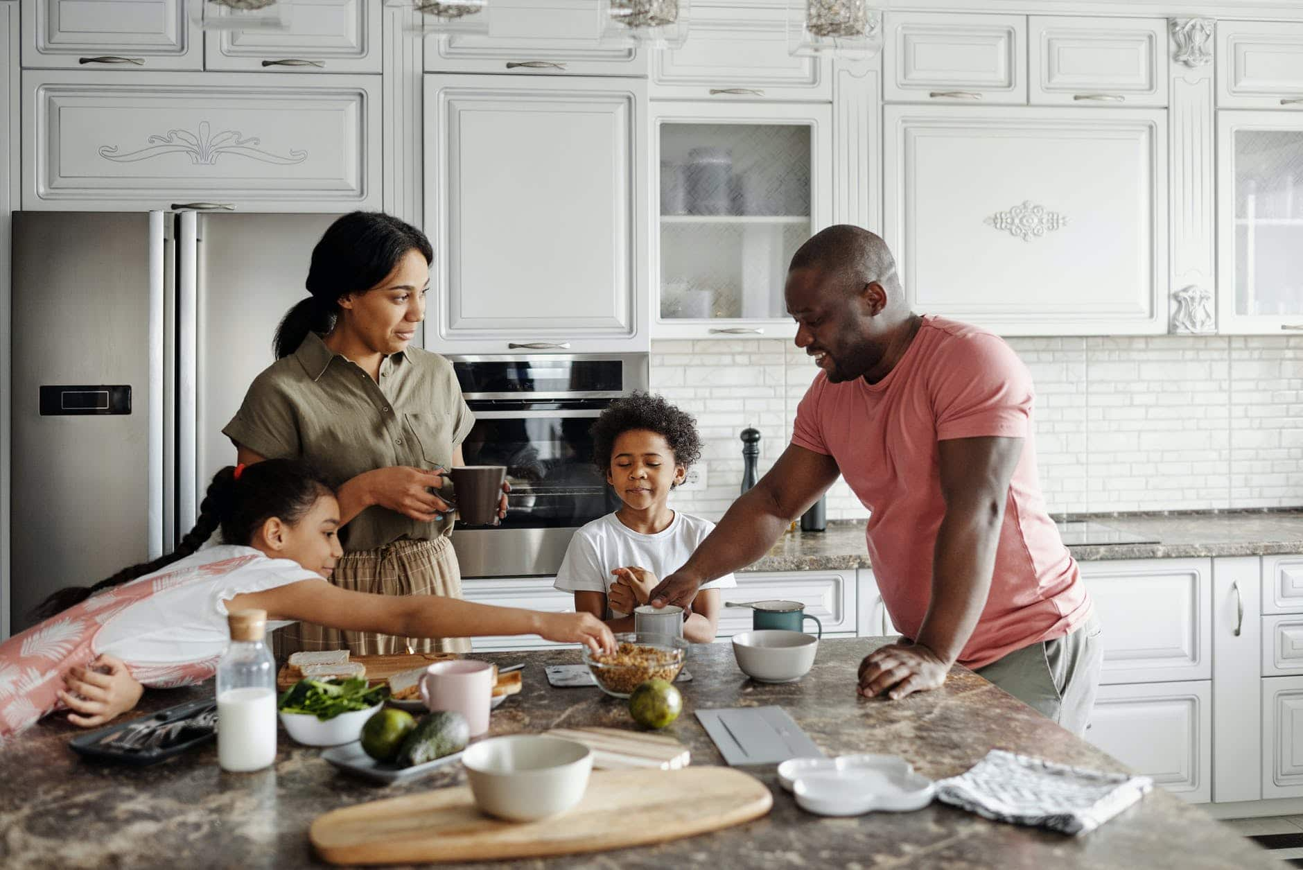 family making breakfast in the kitchen
